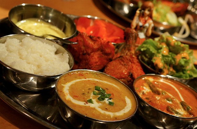 Colorful curries at one of the best restaurants in Boston. Image source: Flickr